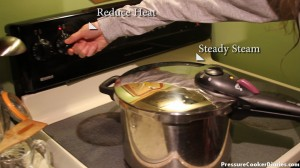 Pressure cooker releasing steady steam